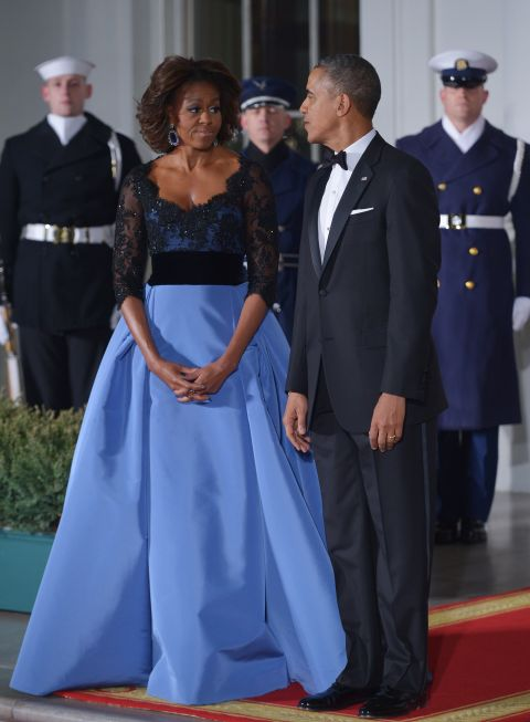 After a year without a State Dinner, the First Lady stunned the nation in this gorgeous Carolina Herrera gown with a sheer, lace overlay and voluminous blue skirt.