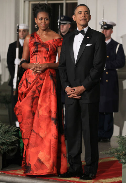 Michelle Obama is the definition of elegance in this stunning, red silk gown by Alexander McQueen.