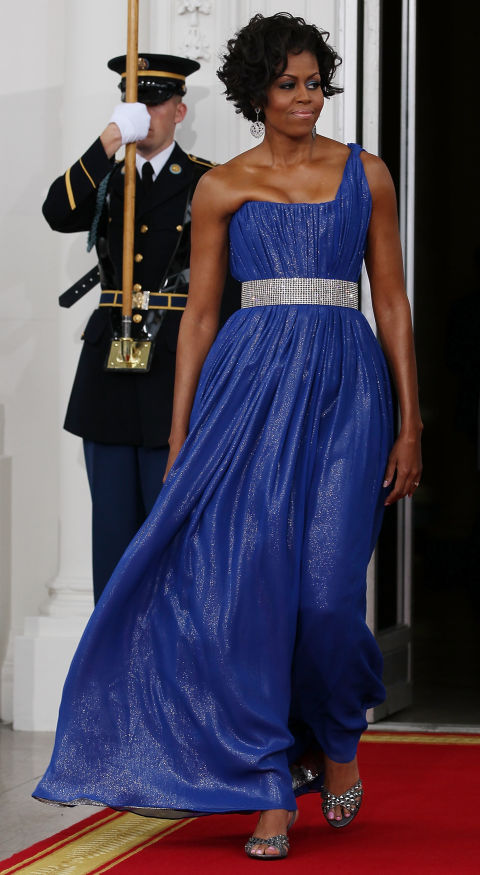 The First Lady sparkles in an electric blue dress by Peter Soronen.