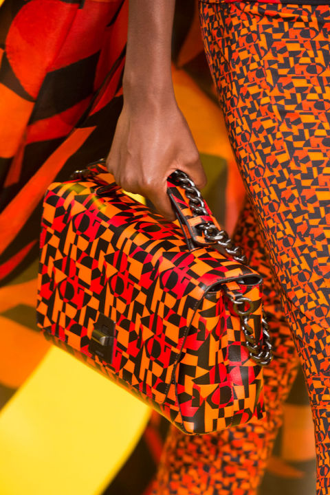 Handbags appear straight out of the Frieze Art Fair, with graphic prints at Versace, pop art phrasing at Loewe and Gucci and painterly details at Prada. Pictured: Akris