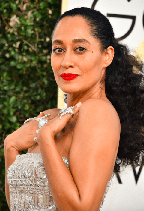 The only beauty statement capable of competing with this  many diamond rings is a pop of matte red lipstick (her makeup artist Jamie Greenberg used a combination of L'Oréal Paris Infallible Lip Paints in 322 and 324.)