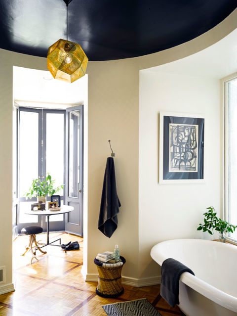 A Tom Dixon pendant lamp and a 1950s print in the master bathroom.<br /><br /><br />