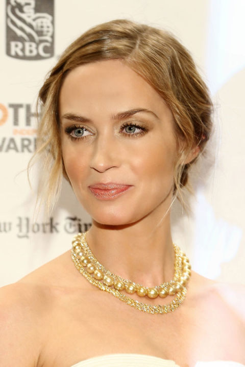 For a sparkly look that doesn't read tacky, strike the right balance by sweeping a neutral eye shadow on your lids and then accentuating with a light dusting of gold around your eyes. Emily Blunt is wearing colors from ck one Eyeshadow Quad in Nymphet ($28). Finish with a pearly metallic rose lipstick.