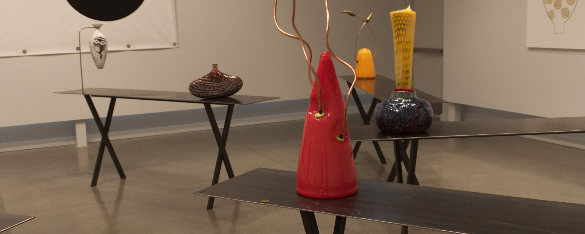 """""""Red Rockets"""" was glass-blown and includes copper pieces. The piece is on display in the JDAC."""