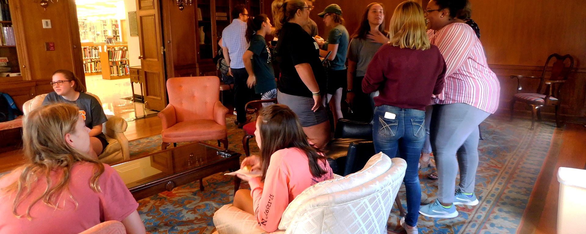 Students mingle at the first Café Français event in Perkins Library.