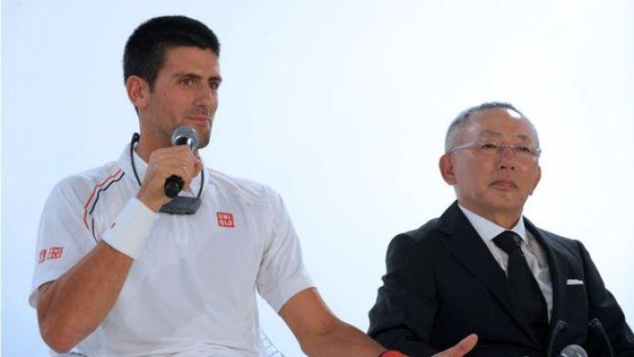 Tadashi Yanai y Novak Djokovic