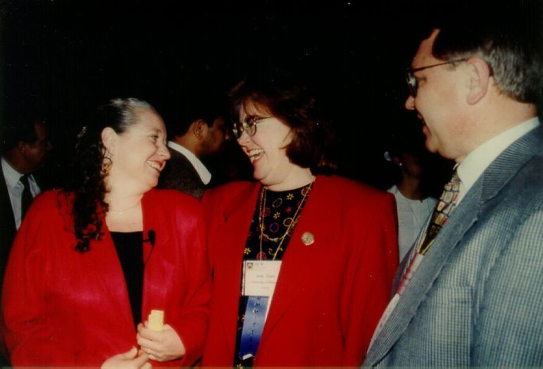 Judy Olson and Wendy Kellogg laugh together as Gary Olson looks on at the ACM CHI Conference on Human Factors in Computing Systems in March 1997 in Atlanta, GA.