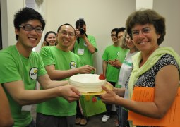 Plaisant receives a cake from grad student Krist Wongsuphasawat at the HCIL Annual Symposium at the University of Maryland in College Park on May 26, 2011.