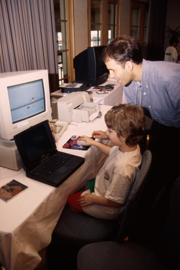 Bederson and a young computer enthusiast at the ACM CHI Conference on Human Factors in Computing Systems in Vancouver, British Columbia, Canada in April 1996.