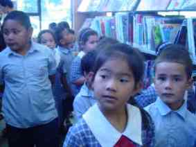 Room 2 walked quietly round the library to see all the different areas there.