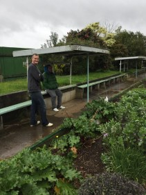 Our parent helpers sheltering from the rain drops!