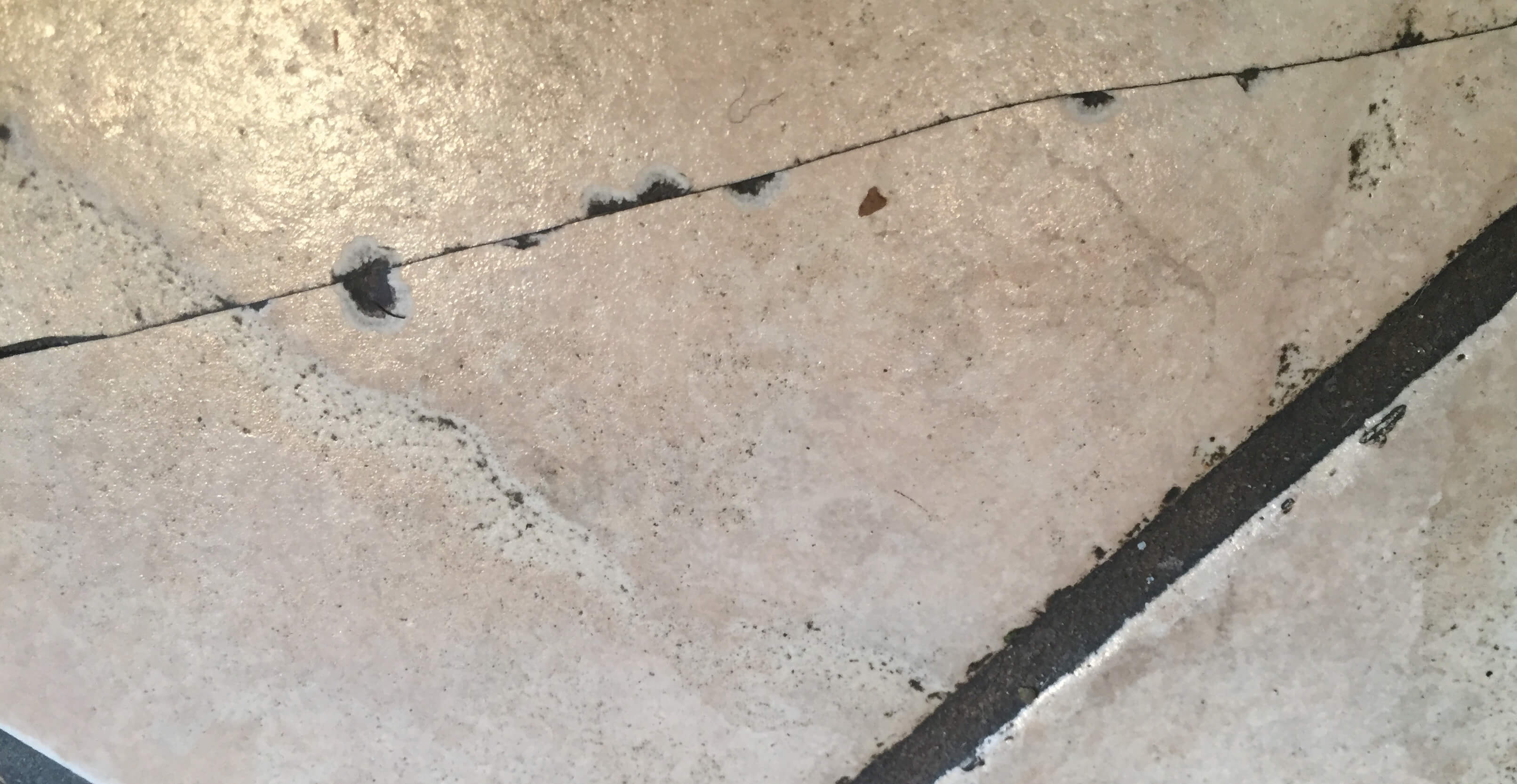 are cracked tile floors signs of