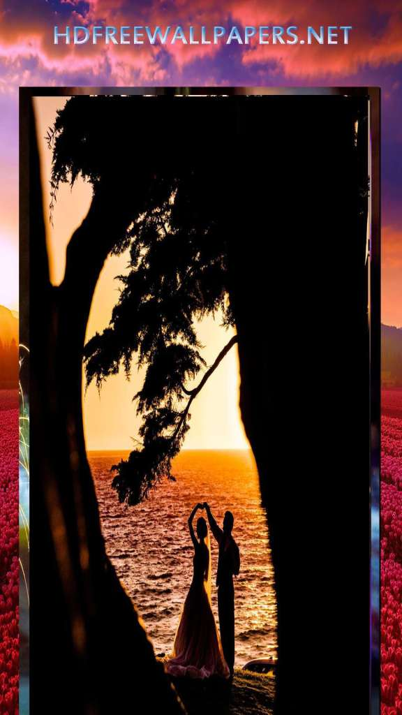 beautiful love between couple near sea wallpaper evening time