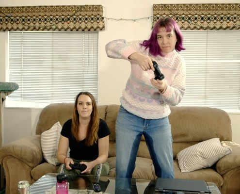 Olivia pees in her pants while playing a video game with Alisha.