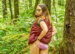 Alisha shows off her wet pink panties in the forest.