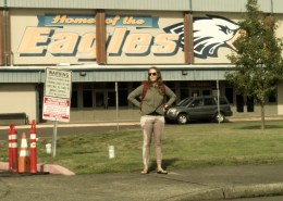 Alisha pees in her light colored pants in front of a high school.