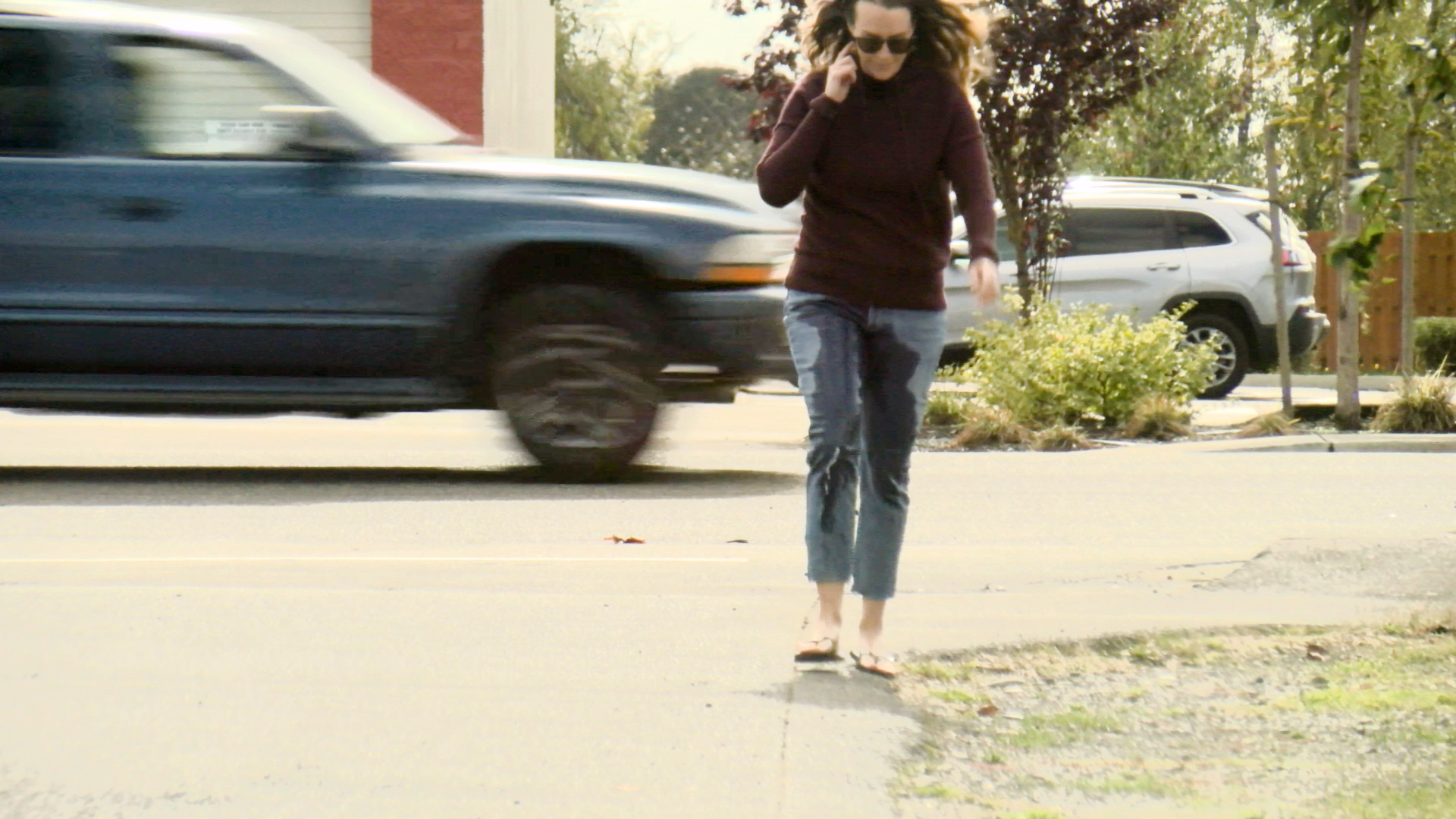 Alisha clearly and visibly wets her pants as she walks across a busy street.