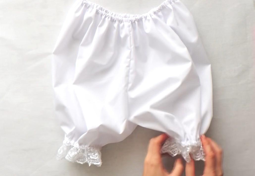 Қыз үшін қуыршақ костюмі үшін панталондар