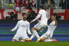Real Madrid's Ramos celebrates his first goal against Bayern Munich with Bale and Pepe (R) during their Champions League semi-final second leg soccer match in Munich