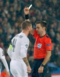 Real Madrid's Sergio Ramos, left, gets the yellow card from referee Nicola Rizzoli of Italy during the Champions League group A soccer match between Paris St Germain and Real Madrid at the Parc des Princes stadium in Paris, Wednesday, Oct. 21, 2015. (AP Photo/Michel Euler)