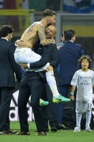 Real Madrid's Spanish defender Sergio Ramos (L) celebrates with Real Madrid's French coach Zinedine Zidane after Real Madrid won the UEFA Champions League final football match over Atletico Madrid at San Siro Stadium in Milan, on May 28, 2016. / AFP / OLIVIER MORIN (Photo credit should read OLIVIER MORIN/AFP/Getty Images)