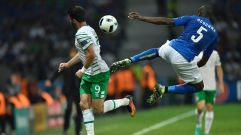 Ireland's forward Shane Long (L) and Italy's defender Angelo Ogbonna vie for the ball during the Euro 2016 group E football match between Italy and Ireland at the Pierre-Mauroy stadium in Villeneuve-d'Ascq, near Lille, on June 22, 2016. / AFP / PHILIPPE LOPEZ (Photo credit should read PHILIPPE LOPEZ/AFP/Getty Images)