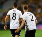 TOPSHOT - Germany's defender Shkodran Mustafi (R) celebrates with Germany's midfielder Mesut Oezil after scoring a goal during the Euro 2016 group C football match between Germany and Ukraine at the Stade Pierre Mauroy in Villeneuve-d'Ascq near Lille on June 12, 2016. / AFP / MARTIN BUREAU (Photo credit should read MARTIN BUREAU/AFP/Getty Images)