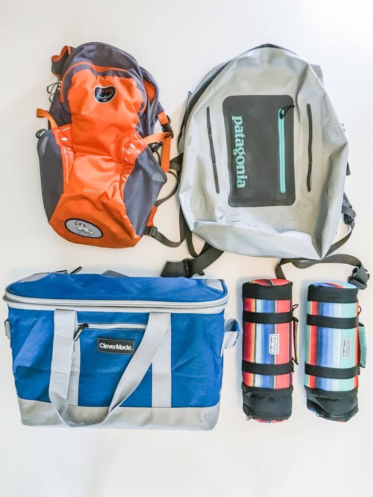 Layflat image of Backpacks and coolers on a white background