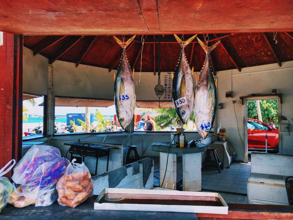 Fish hanging for sale at Rarotonga Saturday Market, Cook Islands