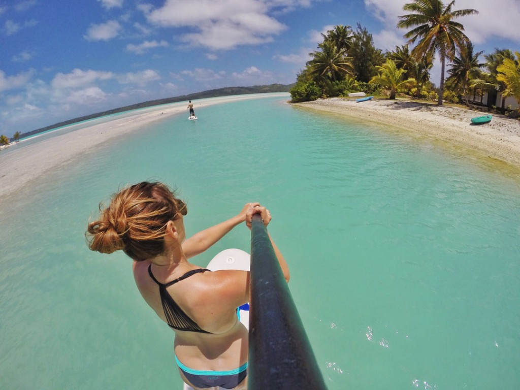 Paddle boarding on Aitutaki Lagoon by Aitutaki Village