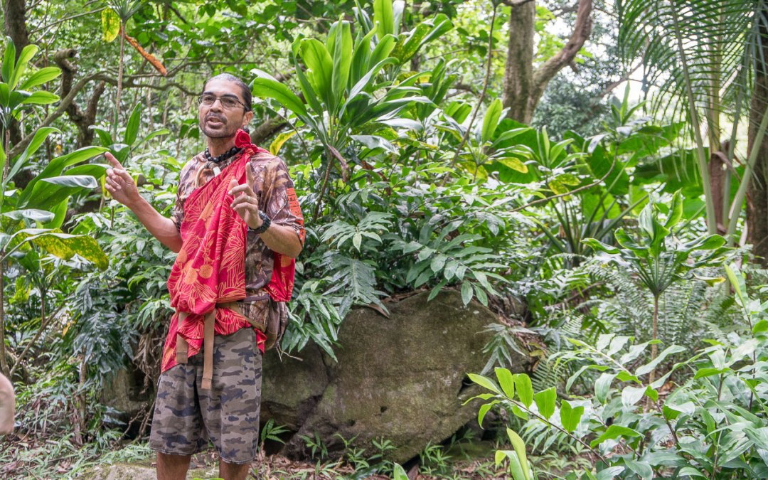 Man standing in front of heiau