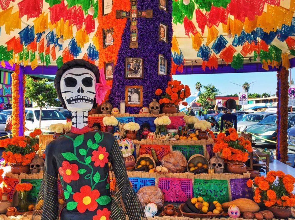 Skull paper sculpture in front of Dia de los Muertos Altar in Tijuana Mexico