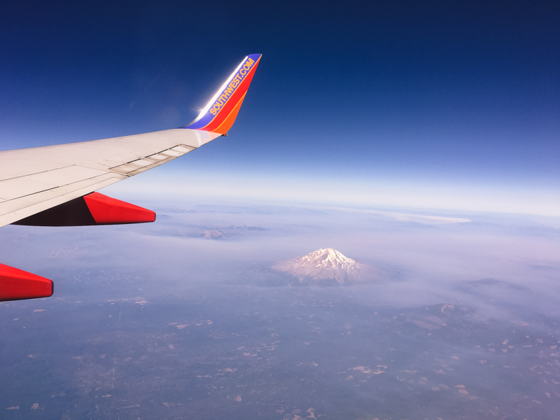 plane flying over Mt Hood
