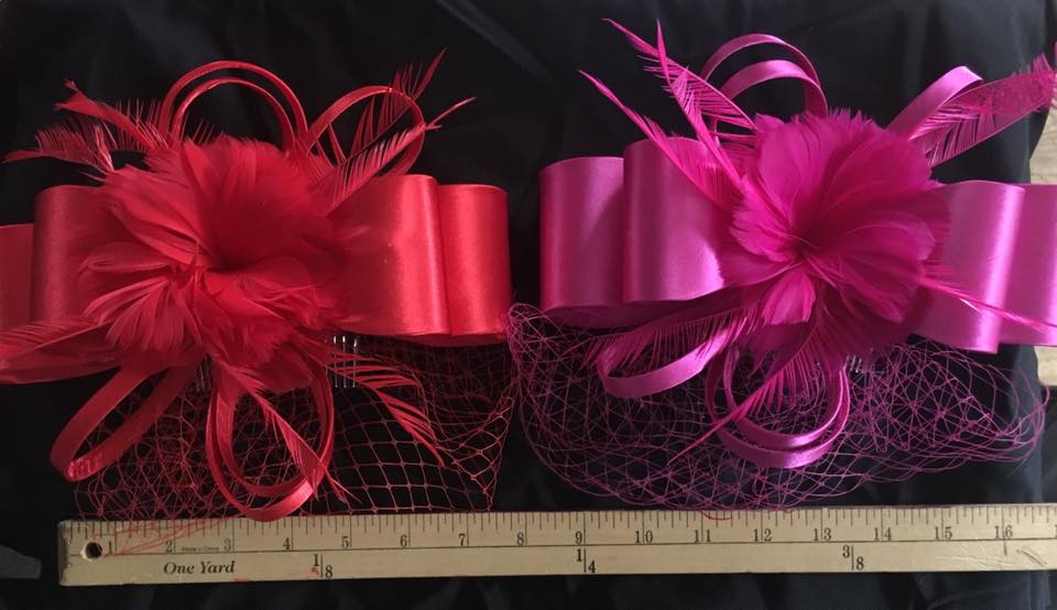 Satin and feather fascinators on comb: $20.00/each