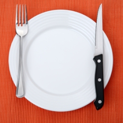 Empty plate on orange background
