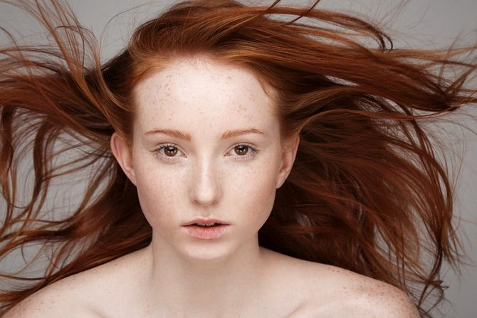 A young woman with flowing red hair