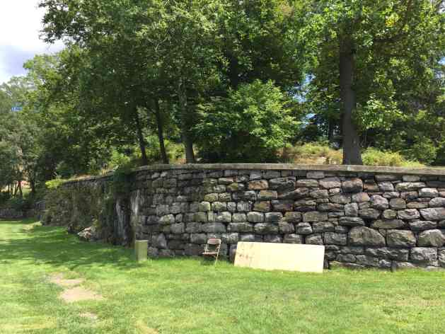 Closeup of the old stone retaining wall