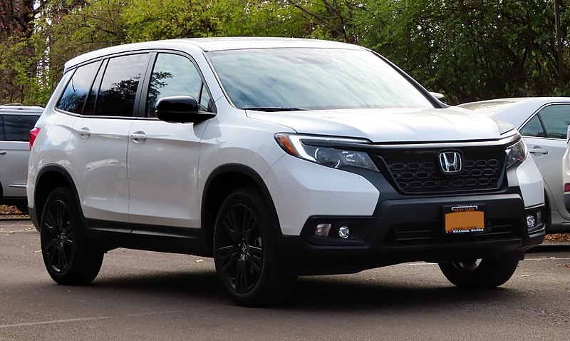 White Honda passport