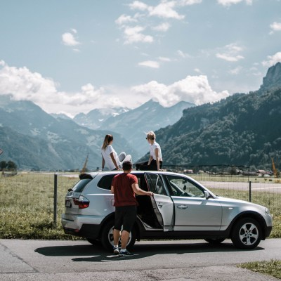 Family SUV in front of mountains
