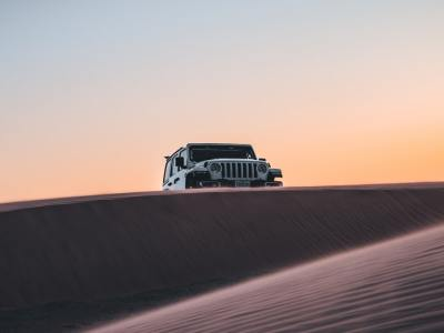 Jeep Wrangler off-roading over the horizon