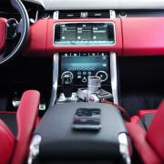 new car tech with red interior in cabin