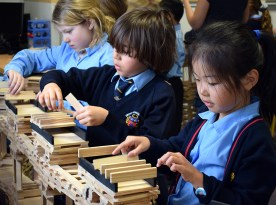 pupils learning co-educational values building with Kapla