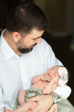 baby girl smiling at dad baby photos charleston sc
