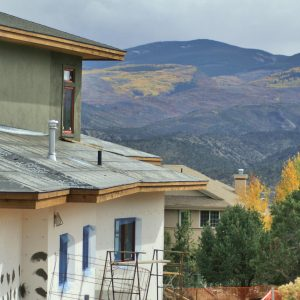 Mountain home being constructed in Autumn