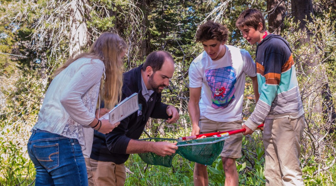 High School students on a science field trip researching macroinvertebrates and water quality.