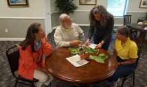 Breyette getting plant ID advice from Eric with Judy Tammi and Ann Murray.
