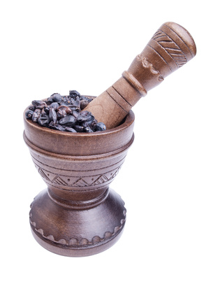 Wooden mortar with dry barberry