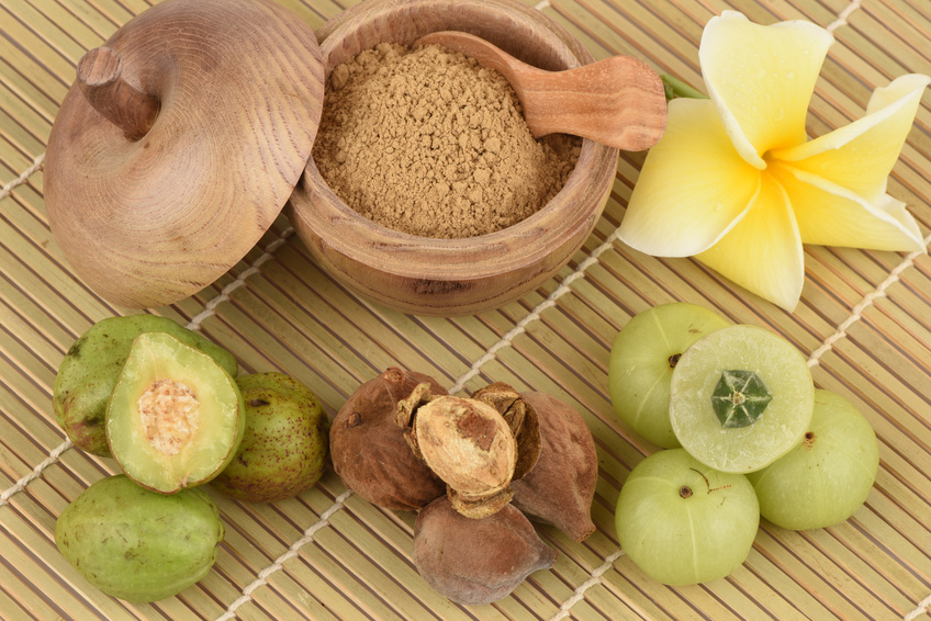 triphala ingredients on a bamboo background