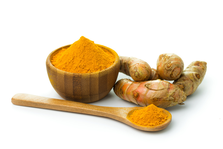 Turmeric and turmeric powder on white background