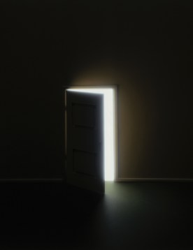 Door opening in darkness, revealing light